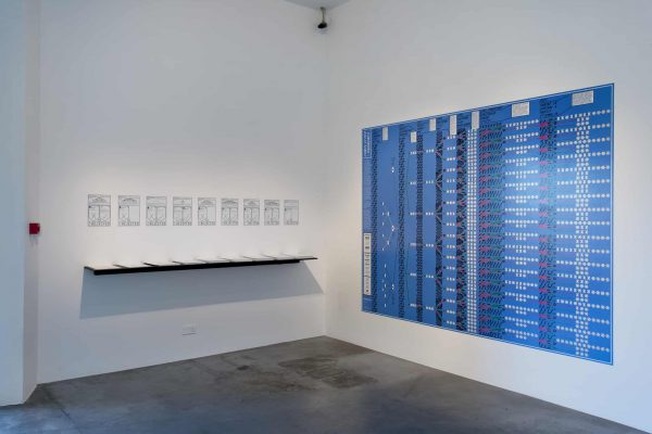 Conflicted Phonemes, 2012 (Vinyl wall prints, Printed sheets on shelf – Installation view, Tate Modern, London, 2013)